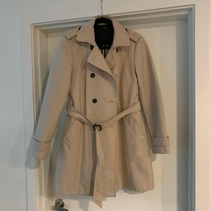Tan trench coat with button details and waist tie